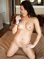 Long haired mom spreads her tight shaved pussy